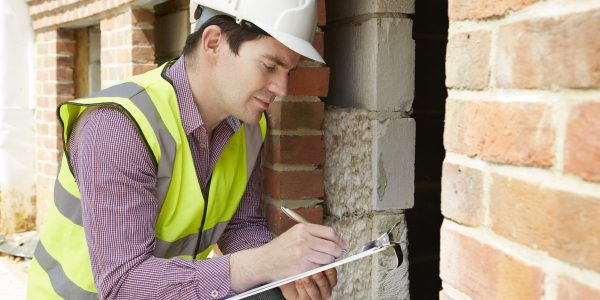 Architect,Checking,Insulation,During,House,Construction